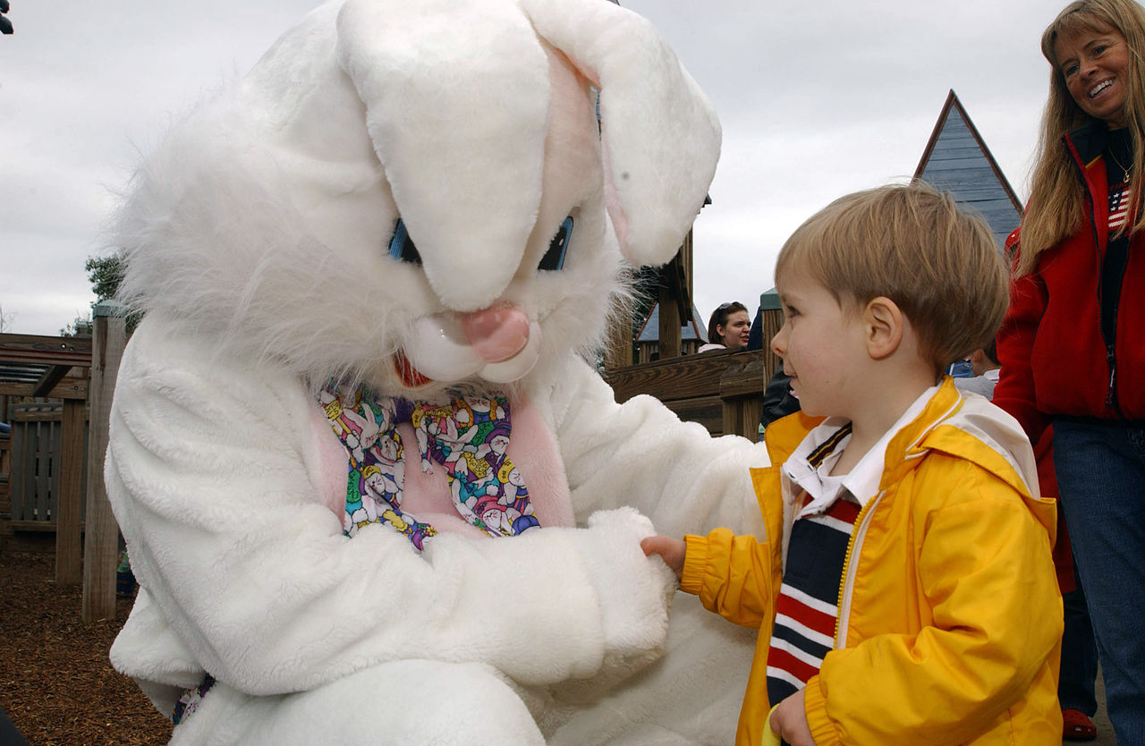 US_Navy_070331-N-2143T-002_Chief_Culinary_Specialist_James_Willis_plays_the_Easter_bunny_as_he_is_greeted_by_children_during_an_Easter_egg_hunt_event